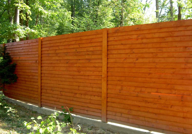 Деревянный забор – как вариант бюджетного ограждения